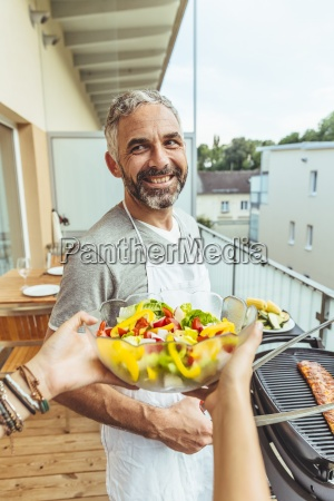 portrait of smiling man barbecuing on