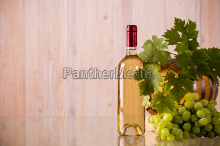 bottle, of, wine, with, a, barrel - 16352763