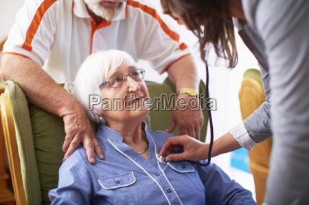 medic caring for senior woman at