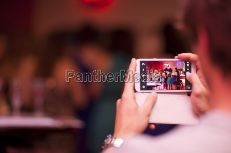 young man photographing on bachelorette party