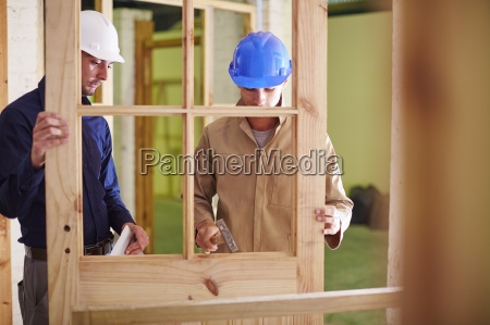 construction worker and foreman working with