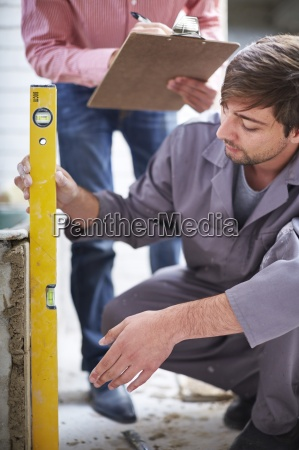 construction worker with spirit level and