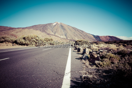 lonely desert road landscape in volcan