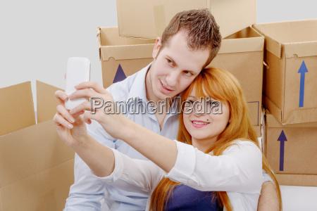 happy, couple, sitting, on, the, floor - 16357279