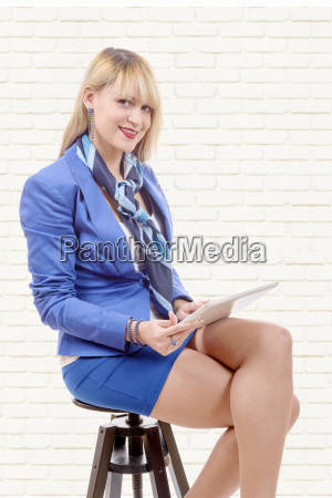 pretty, young, blond, woman, with, tablet, - 16357241