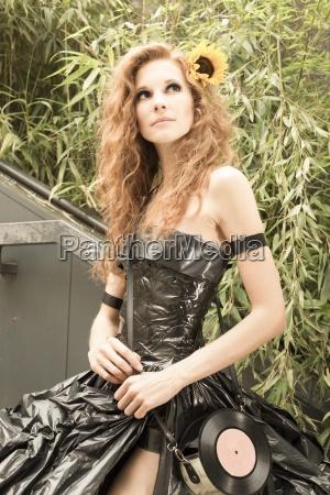 woman wearing dress made from bin
