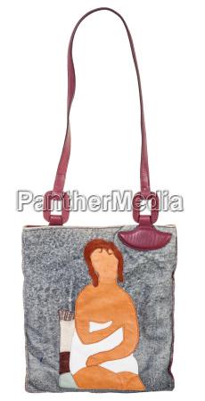 leather handbag decorated female figure applique