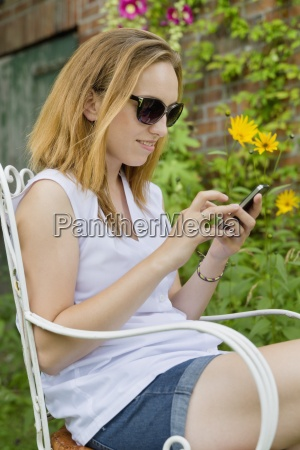 young woman with sunglasses sitting in