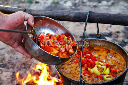 outdoor cooking making soupe on a