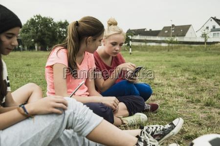 four female teenage friends sitting on