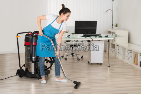 janitor with vacuum cleaner machine