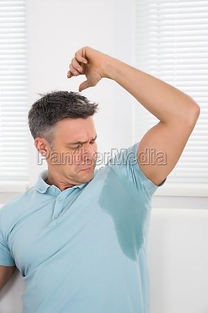man notices his sweat