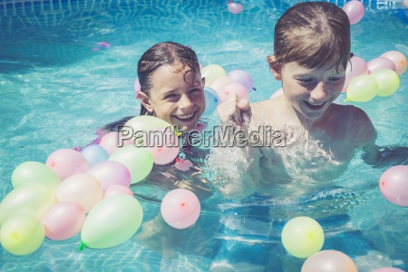 happy boy and girl in swimming