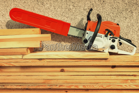 chainsaw and lumber