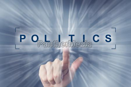 hand clicking on politics button
