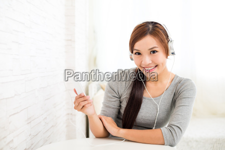 woman wearing headphone with music player