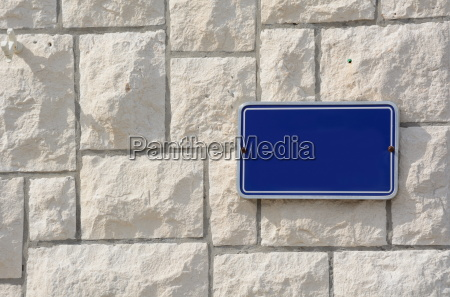blue sign on wall for free