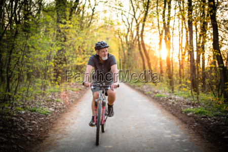 senior man on his mountain bike