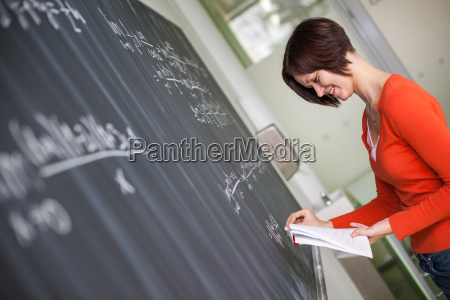 pretty young college studentyoung teacher writing