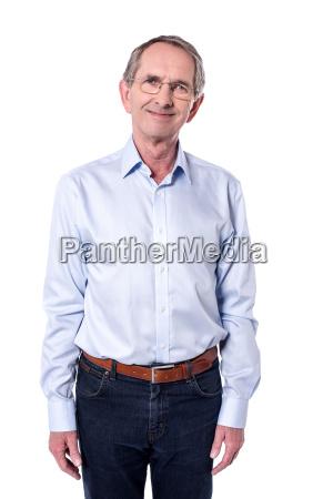 happy senior man posing to camera