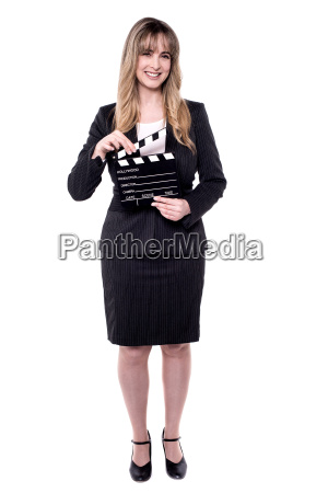 corporate woman holding clapperboard