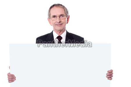 senior business professional displaying blank ad