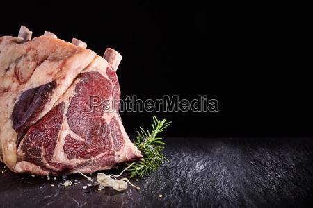 raw beef ribs and seasoning over