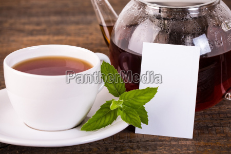 teapot and white cup with white