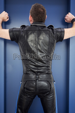backside of man wearing fetish leather