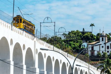 train drives along distinctive white arches