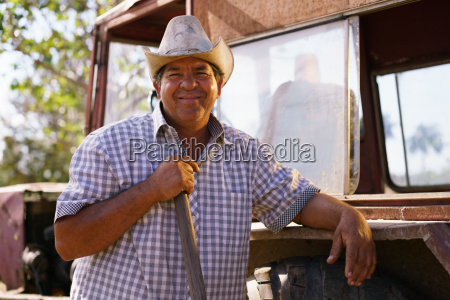 portrait happy man farmer leaning on