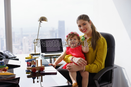 portrait mother business woman playing child