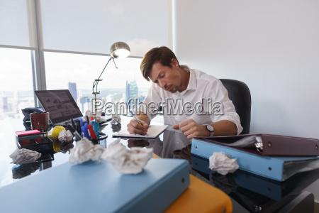 sad business man trying to write