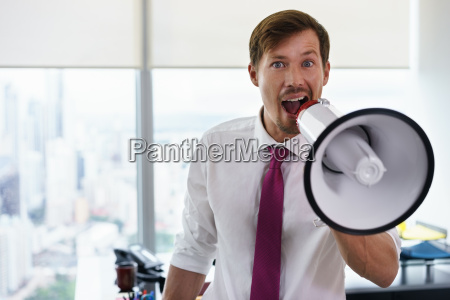 white collar worker with megaphone fighting