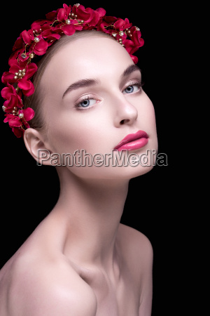 beautiful girl with a wreath on