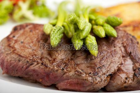 wild asparagus on a steak