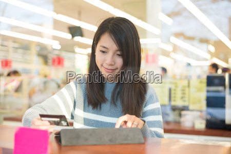 woman using tablet pc for online