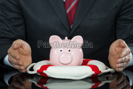 close up of businessman hand protecting