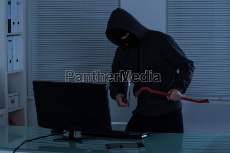 thief stealing laptop