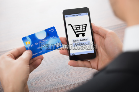 businessman shopping online with mobile phone