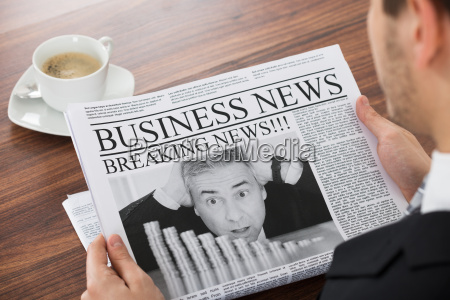businessman reading news in newspaper