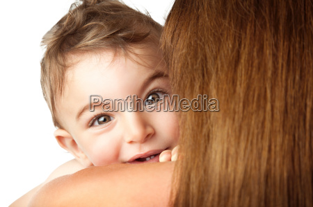 baby boy playing peek a boo