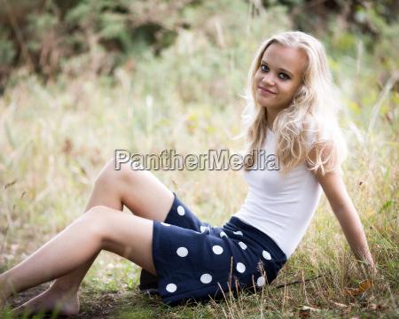 beautiful blond teenage girl outside in