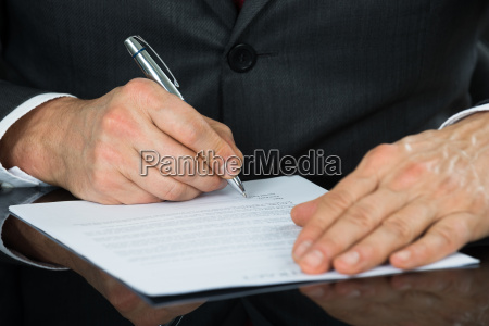 close up of businessman hand holding