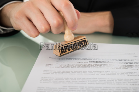 businessman hand approving document