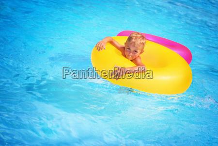 happy boy in swimming pool