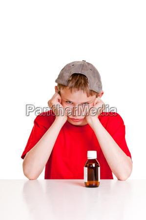 angry teenager behind medicine bottle