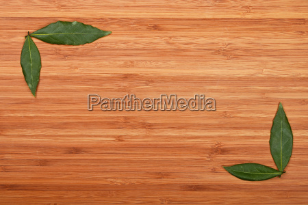 bay leaves frame corners over bamboo