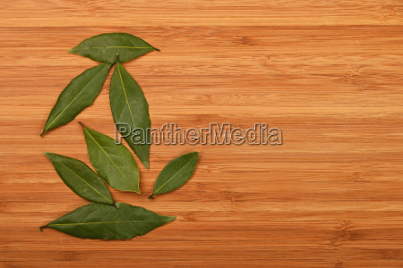 bay laurel leaves on bamboo wooden