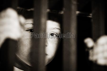 imprisoned child behind bars